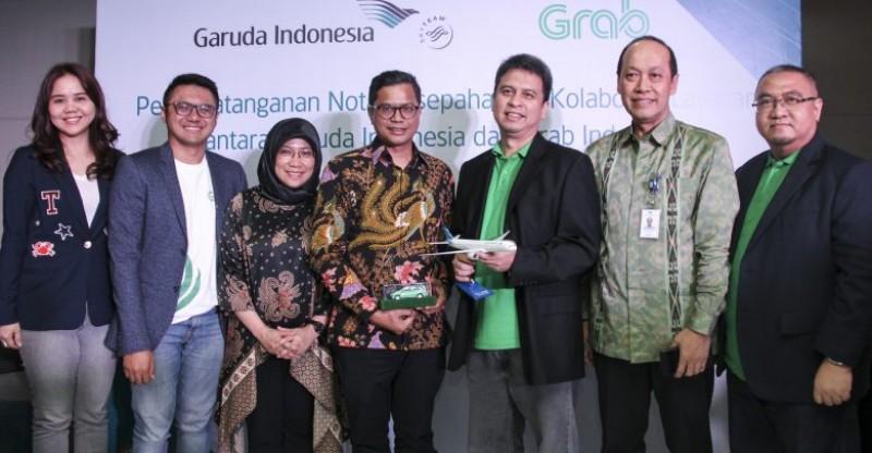 Garuda Indonesia Gandeng Grab Tingkatkan Nila Tambah Bagi Pelanggan